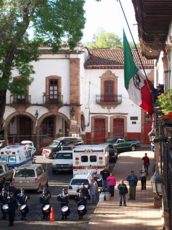 Hotel Los Escudos view from balcony of a flag raising ceremony, Patzcuaro Plaza Principal, Michoacan