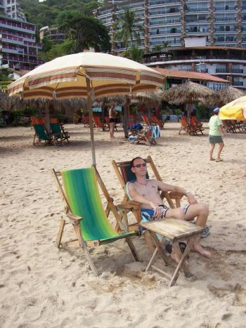 Andrew Wharon relaxes in Puerto Vallarta beach near Blue Chairs bar