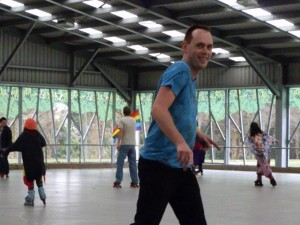 Andrew J. Wharton roller skating at Hamilton's Gay Pride 2012