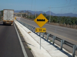 Dave Clingman and Andrew Wharton approach topes (speed bumps) on Mexico cuota (toll road)